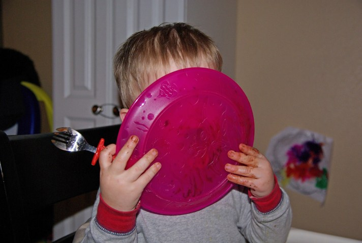 Kid licks plate