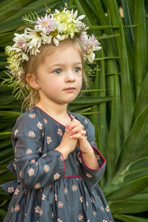 Girl standing in pretty dress with flower crown