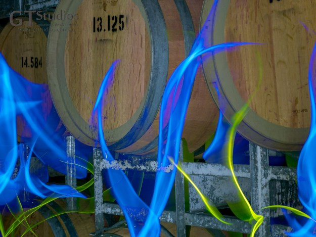 Light Painting with special tools looks like flames among the barrels of vintage wine. At the workshop with Denis Smith at Tanunda