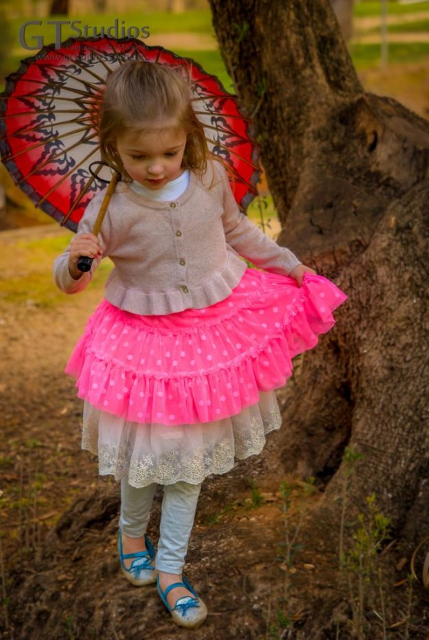 Girl with red parasol & pink tutu