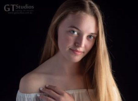 An obvious connection between our subject and photographer at this teen photo experience at GT Studios.