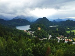 11. In the centre of this photograph is the Schloss Hohenschwangau (High Swan County Palace), one of the two palaces in the village. A little context and history is important here. The palace was built by King Maximillian II, the father of King Ludwig II, and therefore was the childhood residence of the latter. Political assessment of King Ludwig II is not necessarily flattering, but he did commission the Schloss Neuschwanstein (Neuschwanstein Castle), which is now a popular tourist destination in Munich.