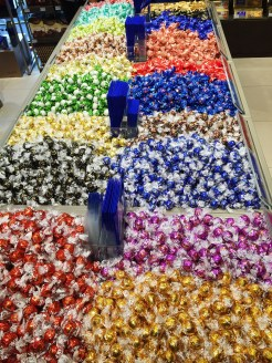 16. Colourful assortment of Lindt chocolates and confectionary at the store in the village.