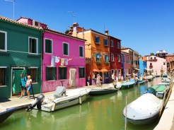 18. Another view of the canals and the colourful houses at Burano. A trip can also be made via the same mode of transportation to the sparsely populated island of Torcello, which houses oft-visited churches and cathedrals, as well as a number of natural attractions.