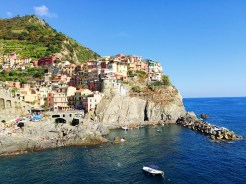 19. The most common photograph of Cinque Terre, taken at the town of Manarola, described as a tiny urban jewel with small, colourful houses in the Genoese style.
