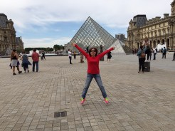 4. Mom posing for a picture at the Musée du Louvre.
