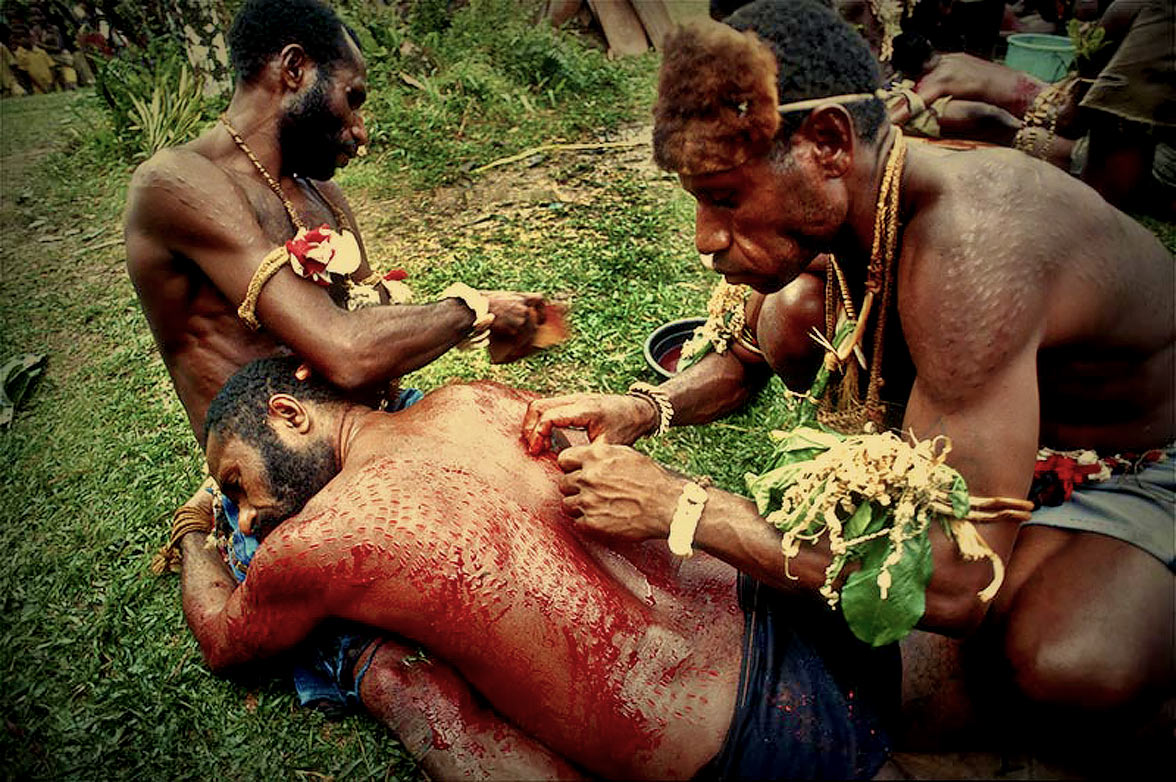 A Tribe In New Guinea Give Men Crocodile Scars To Honour