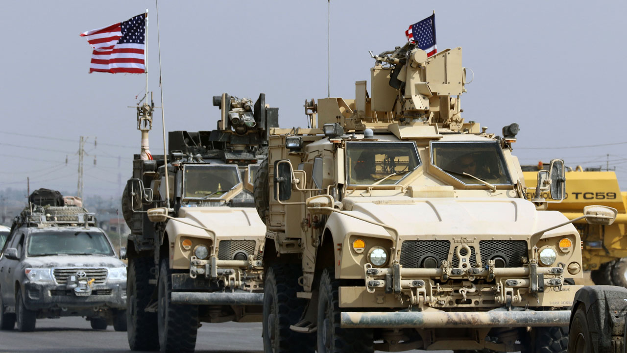 US troops - Iraq says U.S. forces withdrawing from Syria have no approval to stay