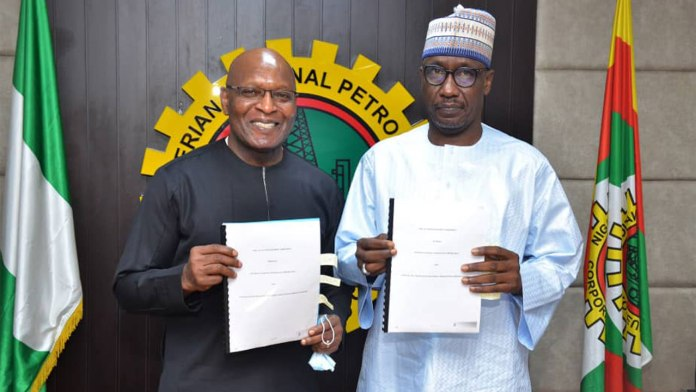 Group Managing Director of SEEPCO Mr Tony Chukwueke with Group Managing Director of NNPC Mallam Mele Kyari at signing of OML 143 Gas Development Deal