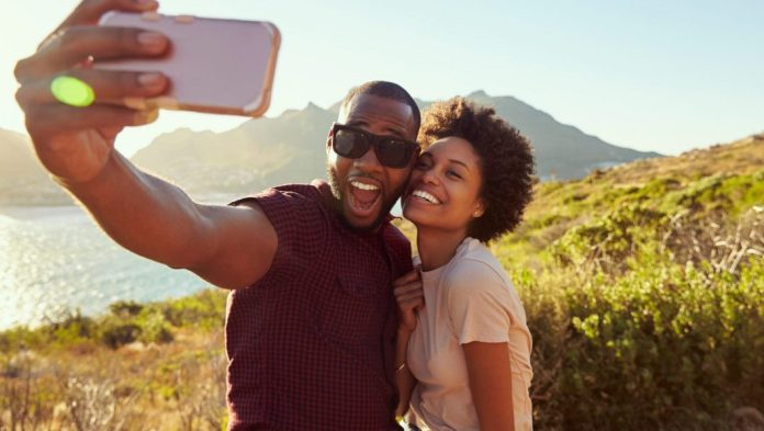 A couple shares a moment for the camera. Photo Shutterstock