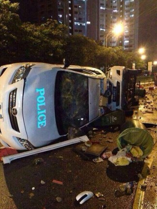 Overturned police cars in Little India