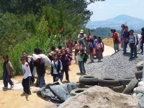 local school kids delivering trash