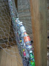 close up: bottles and chicken wire
