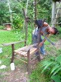 Leonel building a chair with his machete