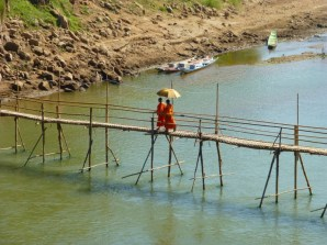 monks crossing the bamboo bridge