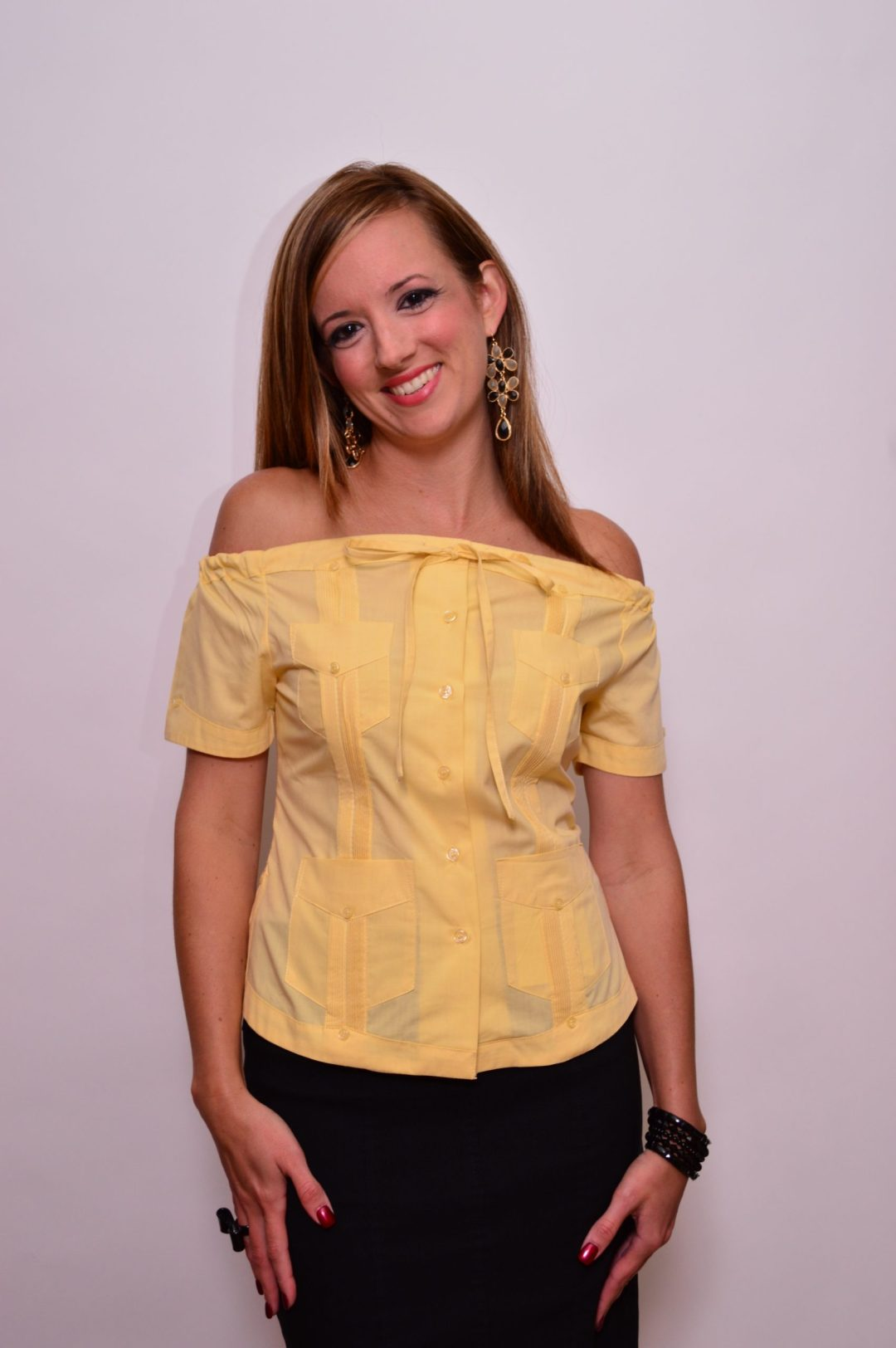 Woman in yellow Guayabera