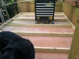 Close up of the shed base completed and one wall being made