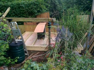 The shed base completed and one wall being made