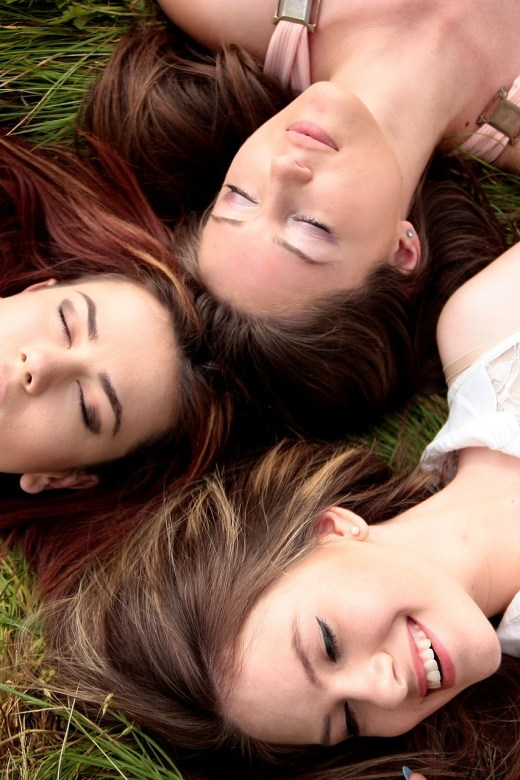 friends lying on the ground