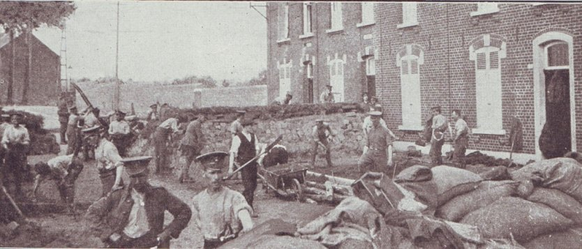 Soldiers of 1st Northumberland Fusiliers preparing street barricades in the Mons area before the fighting started on 23rd August 1914