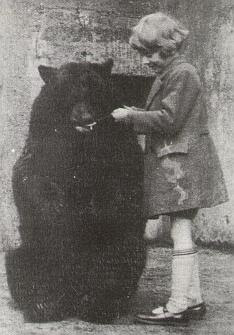 Christopher Robin with Winnie at the London Zoo.