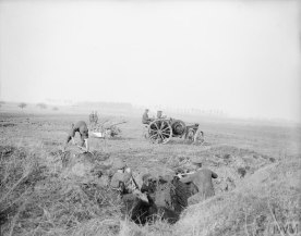 Reclaiming the battlegrounds. Filling in trenches and tractor ploughing at the Agriculture Directorate Farm at Roye, 9 March 1918.