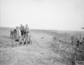 Reclaiming the battleground. Tractor-ploughing at the Agriculture Directorate farm at Roye, 9 March 1918.