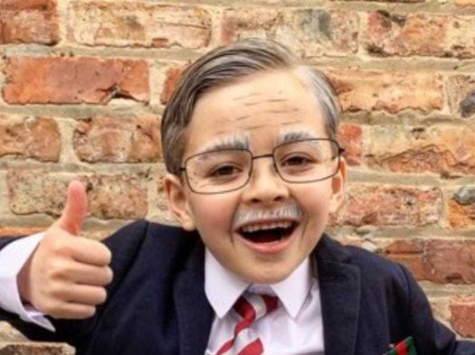 Six-year-old raises thousands by walking laps dressed as ...