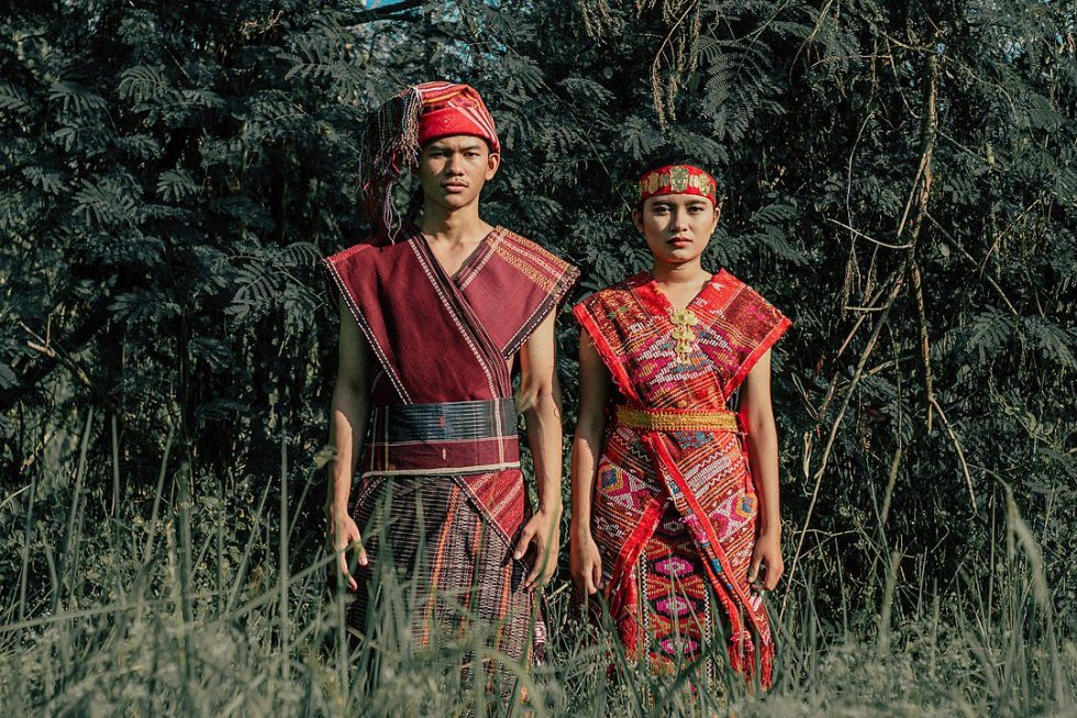 Toba Batak male and female wearing traditional clothes