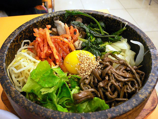 Bibimbap, a Korean traditional dish. Bibim means mixing various ingredients, while bap refers to rice. A raw or fried egg is a common addition.