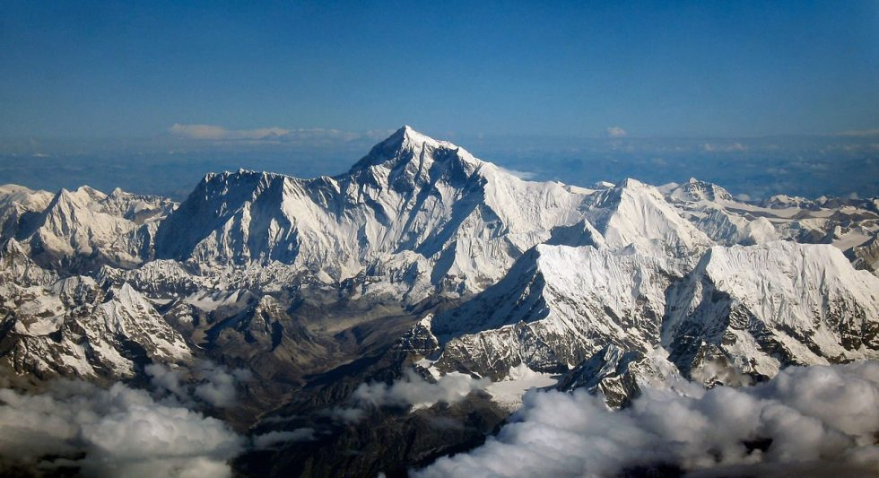 Mount Everest as seen from an aircraft from airline company Drukair in Bhutan. The aircraft is south of the mountains, facing north.