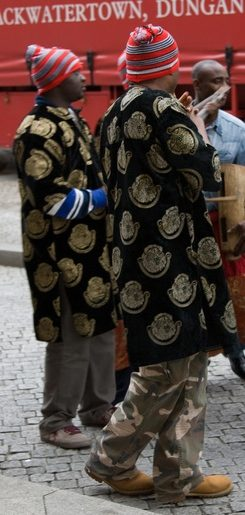 Igbo men wearing the ceremonial Igbo men's hat and Isiagu, a pullover shirt worn on special occassions.