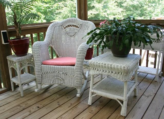 White wicker patio furniture on a balcony