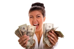 an-excited-woman-with-lots-of-cash