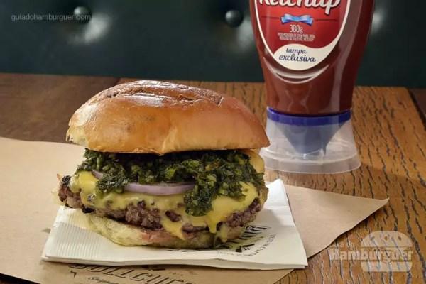 Mujica: Hambúrguer de carne 100% black angus, queijo prato, cebola roxa e molho chimichurri. - R$ 20 - SP Burger Fest