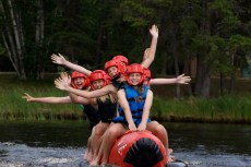 girls on red shark at bible camp