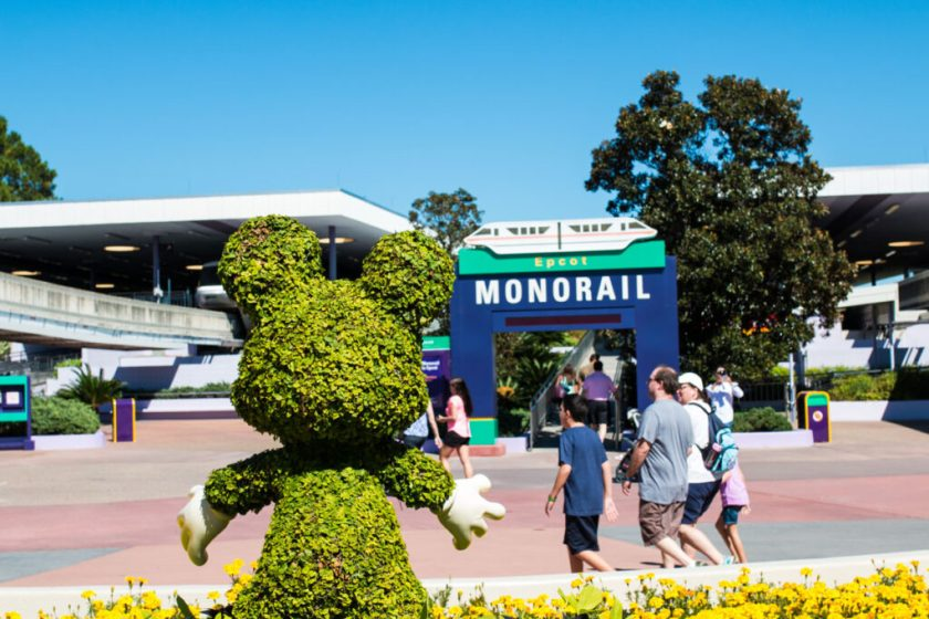 Mickey Topiary at TTC in front of Epcot monorail sign.
