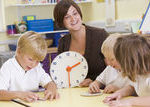 Guided Math lessons meet the needs of students in small group settings like with Telling Time.