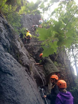 Adventure Week campers climbing up a the Ferrata