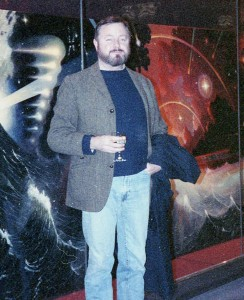 Ingo Swann standing in front of his painting Millennium
