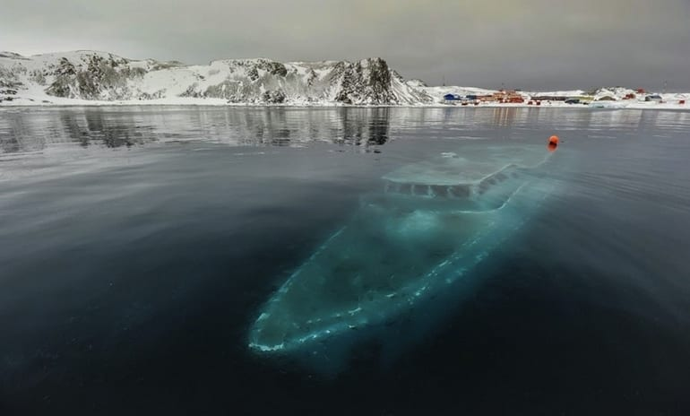 Sunken yacht in Antarctica - Most Beautiful Abandoned Places In The World