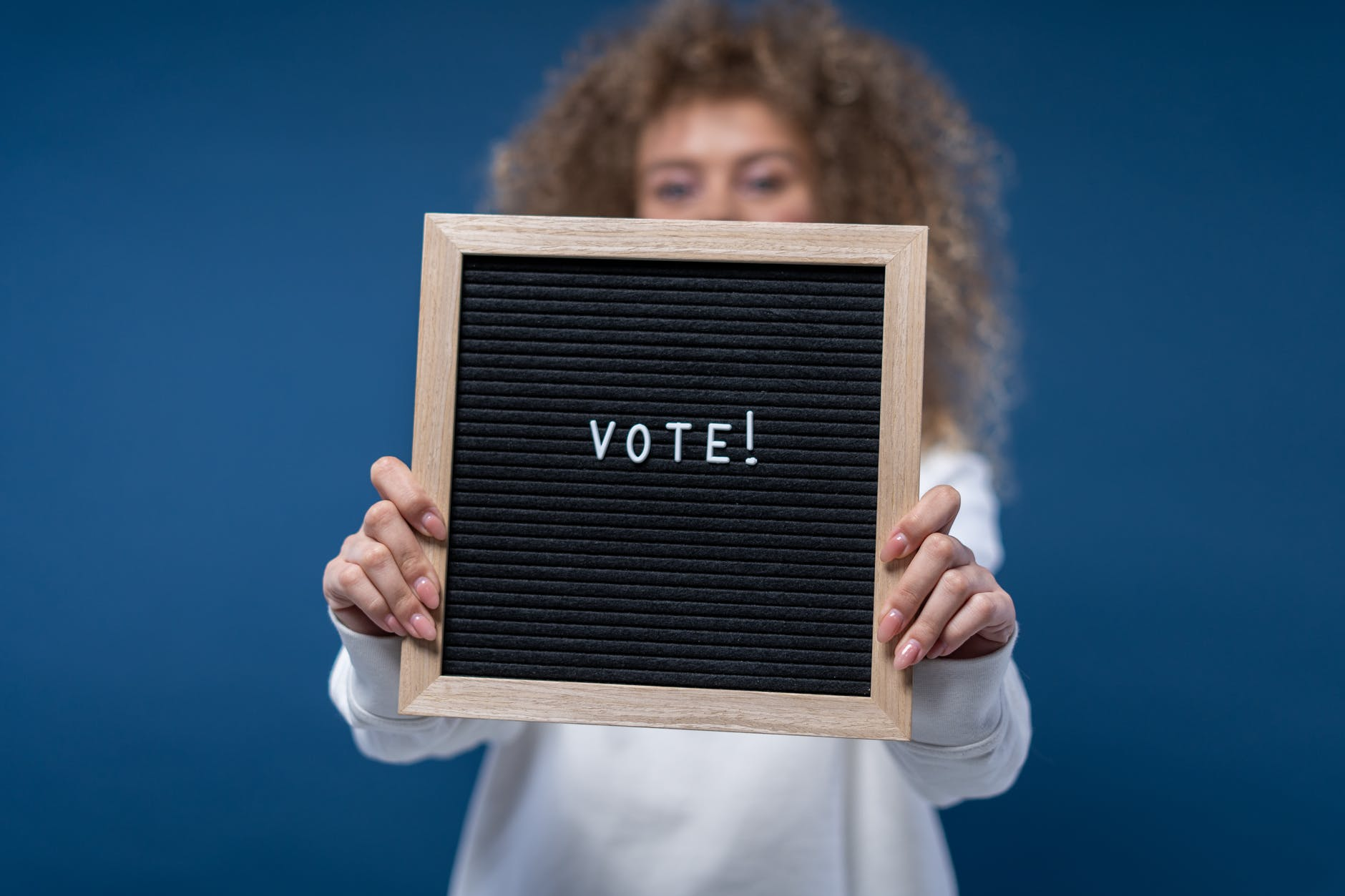 person holding a vote sign