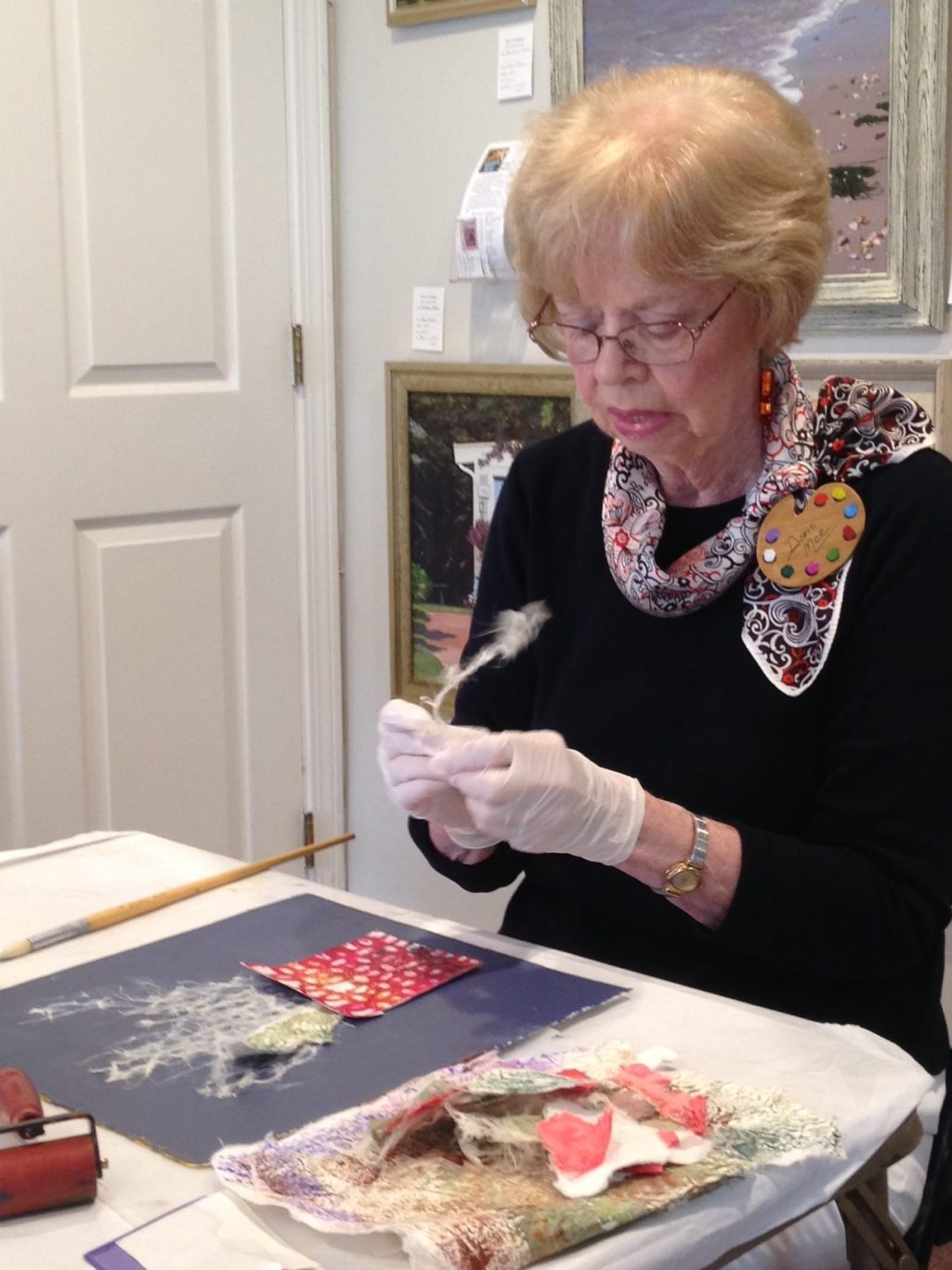 Doris Mee demonstrating her technique of mixed media and collage ©Guild of Harwich Artists