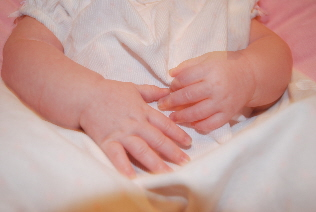Little hands!  So sweet!