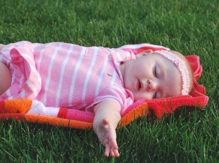 Me touching the grass for the first time!  It feels sooooo good...I could just rest here and sleep, I love it so much!