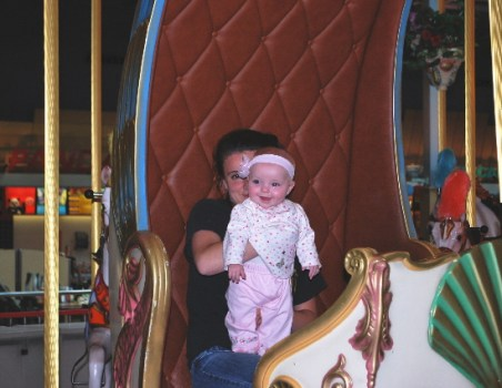 Look at me Mom and Dad... I am so big, and in my first carriage ride on a carousel!