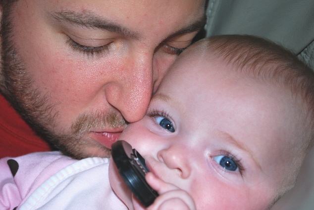 Kisses from Uncle Nick, and Nibbling on the beast's lens cap! Who needs toys!