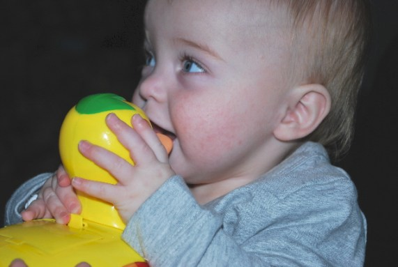 Mom Dad and I playing with my duckie...