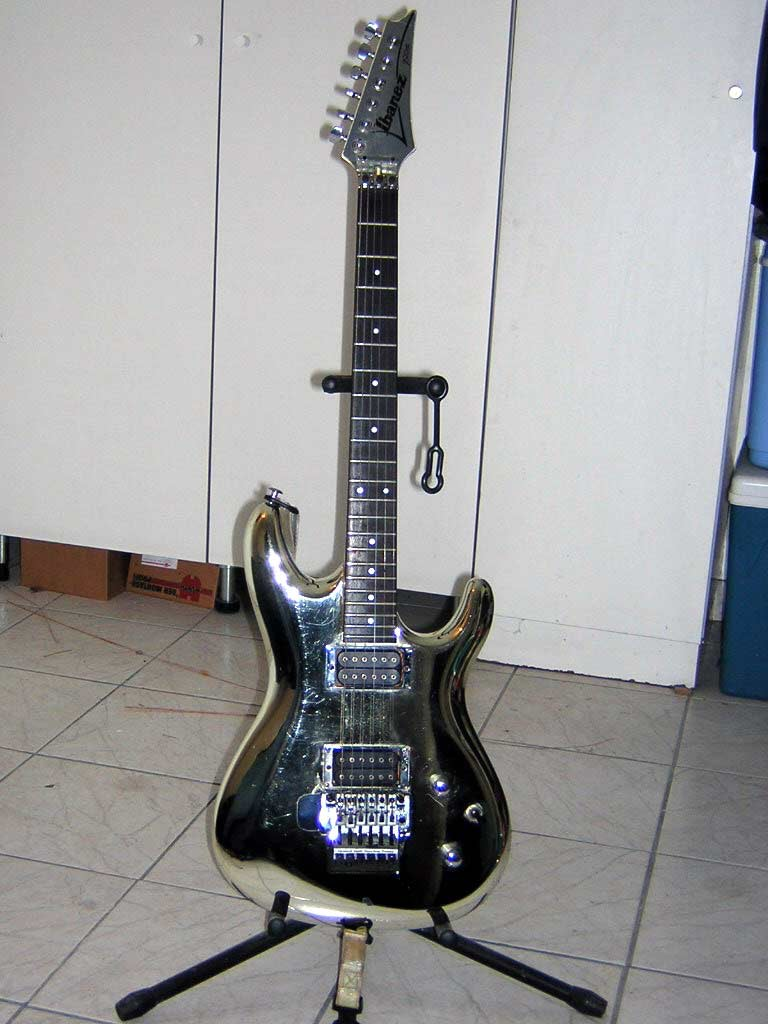 Satriani Chrome Ibanez on a stand