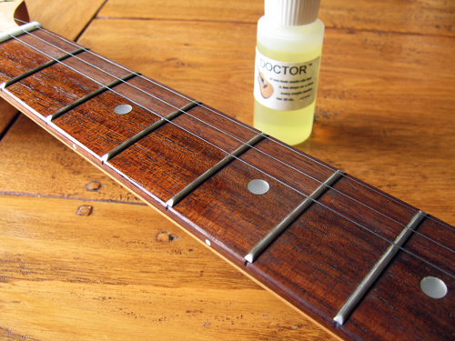 Oil the Fretboard If Needed for guitar tricks